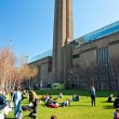 Stock Photo: LONDON - MARCH 19 : Peoples relaxing outside Tate Modern Gal