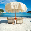 Stock Photo: Two beach chairs with umbrella.