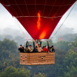 Stock Photo: BAGAN - NOVEMBER 29,: Tourist in Hot Air Balloon over pla