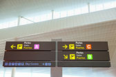 Tourist info signage in airport in international language — Stock Photo