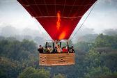 BAGAN - NOVEMBER 29,: Tourist in an Hot Air Balloon over the pla — Stock Photo