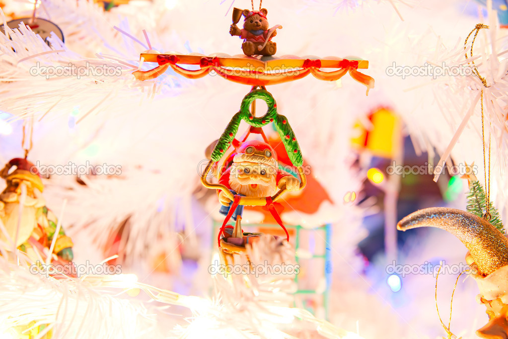 Christmas decorations in a white tree.  Stock Photo #12236395