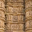 Kamasutrscene on wall of Temple in Khajuraho. — Stock Photo #12420503