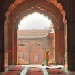 Praying at the Jama Masjid Mosque, old Delhi, India. - Stock Photo