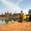 Family visiting Angkor Wat at sunset, Cambodia. — Stock Photo