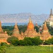 Buddhist Pagodas and Gawdawpalin Pahto, Bagan, Myanmar. - Foto de Stock