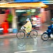 Motion blur astract of a bike and a motorbike rider in Ho Chi Mi - Stock Photo