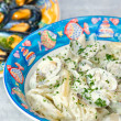 Penne in Barca (Penne with milk and clams) and Mussels. - Stock Photo