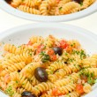 Fusilli with cheese, fresh tomatoes and olives. — Stock Photo