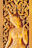 Golden Apsara carbved on a door, Luang prabang, laos. — Stock Photo