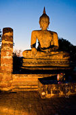 Buddha illuminated at night, Sukhothai, Thailand, — Photo
