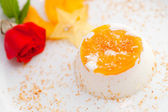 Italian dessert panna cotta on white plate decorated with coconut milk and peach. — Stock Photo