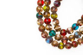 Close-up picture of a Mala made of colored glass. — Stock Photo