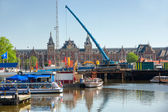 Amsterdam, Canal and houseboat — Stock Photo