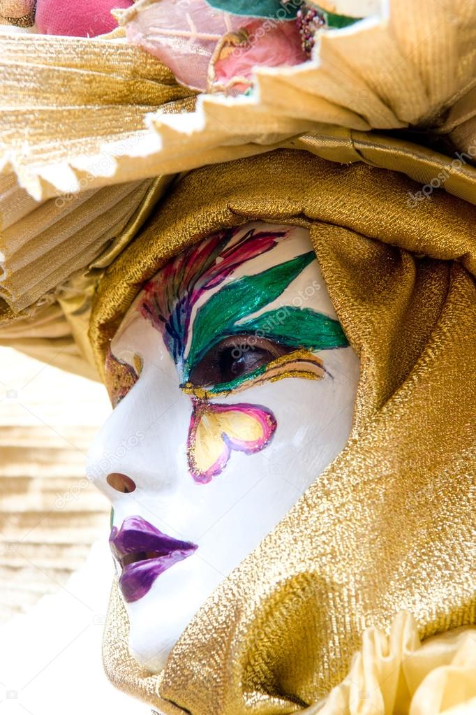 Two golden mask in Venice, Italy. — Stock Photo #12421160