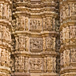 Kamasutra scene on the wall of a Temple in Khajuraho. — Stock Photo