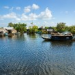 Floating House and  Houseboat on the Tonle Sap lake, Cambodia. - Stock Photo
