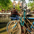 Amsterdam, Canal and bike. - Stock Photo
