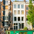 Amsterdam, Canal and houseboat - Stock Photo