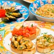 Three dish of seafood, Mix Bruschetta, Rice with squid and Seafo — Stock Photo #13827733