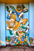 Ramayana scene carved on a wall of a temple in Vientiane, Laos. — Stock Photo