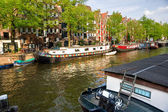 Amsterdam, Canals, boat and bike. — Stock Photo