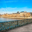 Louvre Museum and Pont ses arts, Paris - France - Stock Photo
