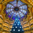Royalty-Free Stock Photo: PARIS - DECEMBER 07: The Christmas tree at Galeries Lafayette on