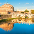 View on famous Saint Angel castle and bridge over the Tiber rive — Stock Photo