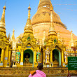 Young Lady monk praying at the Shwedagon Paya, Yangoon, Myanmar. - Stock Photo