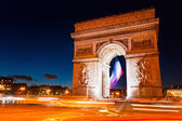 Paris, Arc de Triomphe by night — Stock Photo