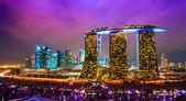 Singapore city skyline at sunset. — Stockfoto