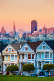 The Painted Ladies of San Francisco, California sit glowing amid — Stock Photo
