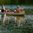 Family Canoeing at Lake — Stock Photo #12779254