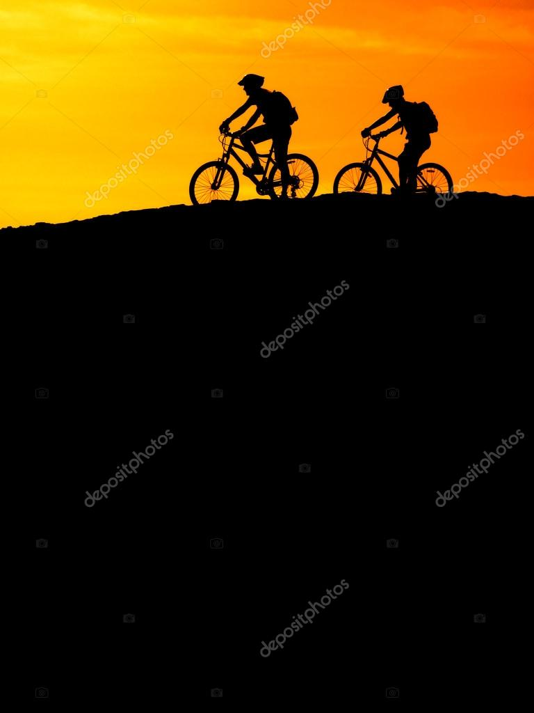 Mountain biking up a trail in the mountains  Stock Photo #12806506
