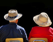 Old Couple Wearing Hats with Black Background — Stock Photo