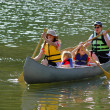 Stock Photo: Family Canoeing at Lake