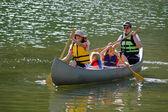 Family Canoeing at Lake — Stock Photo