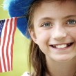 Smiling Girl with Flag — Stock Photo #14423671