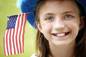 Smiling Girl with Flag — Stock Photo