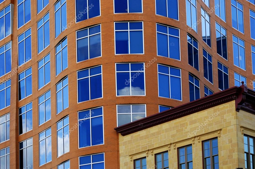 Office building details reflecting, blue sky  in windows — Stock Photo #14423013