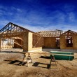 Construction of New Home in Development - Stock Photo