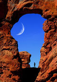 Man Hiking Under Arch with Moon — Stock Photo