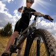 Woman Mountain Biking and Sunshine — Stock Photo #19226597