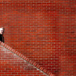 Royalty-Free Stock Photo: Men Walking down Stairs Brick Wall