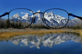 Glasses and Clear Vision of Mountains — Stock Photo