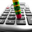 Crunching the numbers on Calculator — Stock Photo