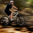 Young Woman Mountain Biking — Stock Photo