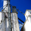 Stock Photo: Tall White Grain Storage with Blue Sky
