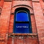 Lawyer Sign on Window — Stock Photo